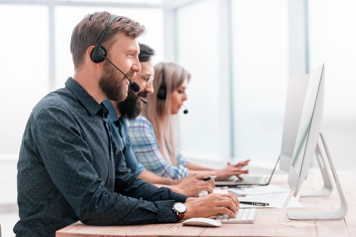 close-up-call-center-employees-work-on-modern-computers-1200x800.jpg