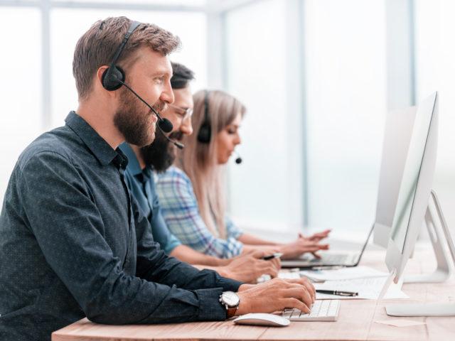 close-up-call-center-employees-work-on-modern-computers-640x480.jpg